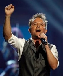 Chris Tomlin performs at the Dove awards in Nashville, Tenn., Thursday, April 23, 2009. The Dove awards honor Christian and gospel music. (AP Photo/Mark Humphrey)