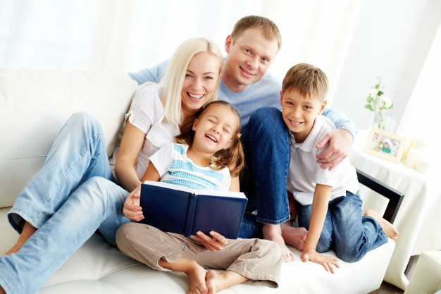 happy-family-reading-a-book_1098-1493